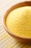 Corn flour. Wooden bowl full of Corn flour Royalty Free Stock Photos