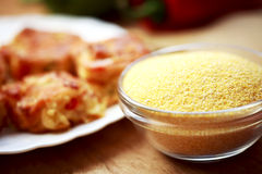 Corn flour on a wooden table in a bowl Stock Photography