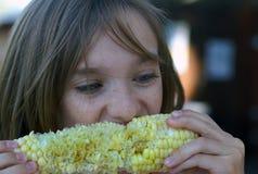 Corn & Freckles. Little girl eating corn on the cob Stock Photos