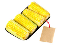 Corn, Fresh corn cobs on package with label Royalty Free Stock Image