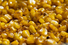 Corn fried in oil. In a frying pan Stock Image
