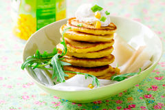 Corn fritters  with sour cream Royalty Free Stock Image
