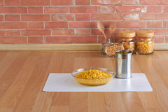 Corn in the glass bowl and can Royalty Free Stock Photo