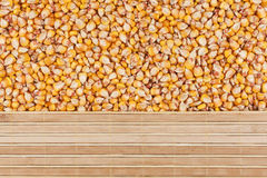 Corn grain and bamboo mat Royalty Free Stock Photography
