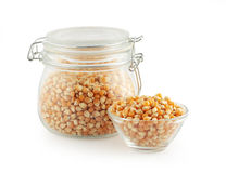 Corn grain in glass kitchen utensils. On white background Royalty Free Stock Photography