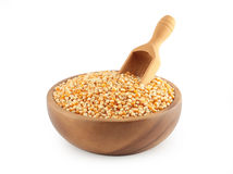 Corn grain in wooden bowl with a scoop. Corn grain in wooden  bowl with a scoop on white background Royalty Free Stock Images