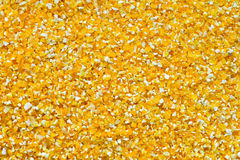 Corn grits background. Yellow corn grits background close up Stock Photography