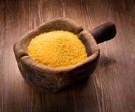 Corn grits on wooden Royalty Free Stock Photography