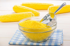 Corn grits on a wooden background Royalty Free Stock Images