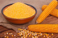 Corn groats in a bowl Stock Photo