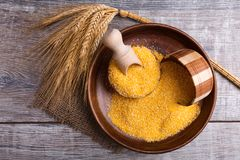 Corn cereals in a wooden plate and in pots. View from above stock image