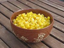 Corn in red terracotta bowl royalty free stock photography