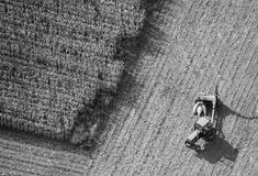 Corn Harvest aerial photo. Aerial photo of farm tractor harvesting Indiana corn from farming field royalty free stock photography