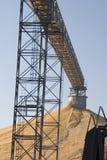 Corn harvest pile. Corn harvest elevator conveyor pile Royalty Free Stock Photos