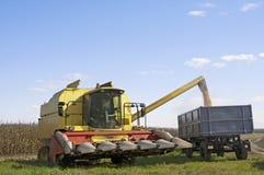 Corn harvester loading trailer Stock Images