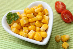 Corn in a heart bowl Royalty Free Stock Photography