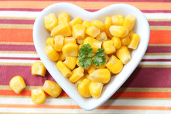 Corn in a heart bowl Stock Photography