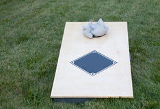 Corn hole boards with bags. Corn hole boards with bags in a backyard stock photos