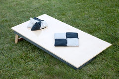 Corn hole boards with bags. Corn hole boards with bags in a backyard royalty free stock images
