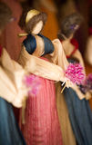Corn Husk Doll. Corn hust doll with woll hair and a flower Royalty Free Stock Images