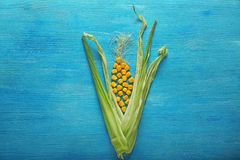 Free Corn Husk With Kernels On Color Wooden Table Royalty Free Stock Image - 151175556