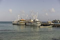 Corn Islad, Nicaragua - 23 August, 2016: great beach in the caribbean with some boats to transport tourists. Boats in a Nicaraguan port, a very good day with stock images