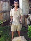 Corn Island Nicaragua man fresh snails Royalty Free Stock Photo
