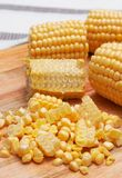 Corn kernels on the wooden board royalty free stock photos