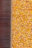 Corn  lying on dark bamboo mat, for menu Royalty Free Stock Photo