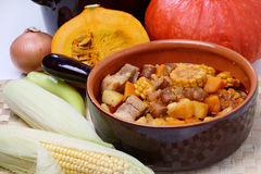 Corn, meat and pumpkin stew. In ceramic bowl Stock Photo
