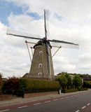 Corn mill besides a road Stock Image