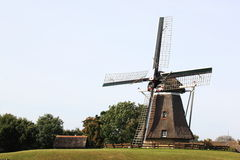 Corn mill De Phenix of Nes, Ameland Island, Holland royalty free stock images