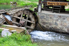 Corn mill. Old water wheel corn mill in Mara, Maramures county,Romania stock images