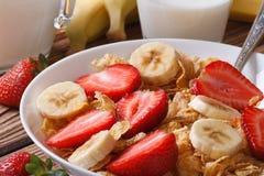 Corn muesli with strawberries and banana close up horizontal Stock Image