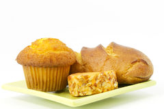 Corn muffin, baked bread, and cheddar cheese Royalty Free Stock Photo