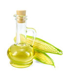 Corn oil in a carafe with two cobs Royalty Free Stock Photos