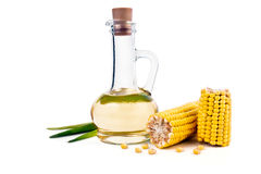 Corn oil. In the decanter, corn cobs and grain isolated on white background Royalty Free Stock Images