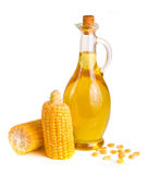 Corn oil in decanter, fresh corn cobs and grains isolated on white background.  Stock Photography