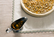 Corn and oil on a table. Corn oil on a table Royalty Free Stock Photos