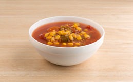 Corn okra and tomatoes in a white bowl on table Stock Photography
