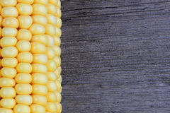 Corn on old wood. Close up Stock Images