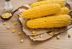 Corn on paper on table Royalty Free Stock Images