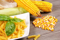 Corn and pasta. Fresh organic corn with pasta on the table Stock Photography