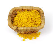 Corn Pasta Shells Overhead View. Natural corn pasta shells in a sturdy woven basket Royalty Free Stock Image