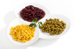 Corn,peas and beans on white bowls Stock Photo