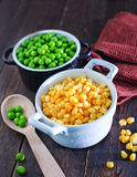 Corn and peas. Sweet corn and green peas in bowl Stock Photo