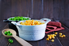 Corn and peas. Sweet corn and green peas in bowl Stock Photos