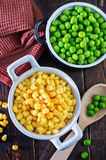 Corn and peas. Sweet corn and green peas in bowl Royalty Free Stock Image