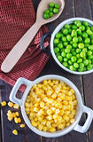 Corn and peas. Sweet corn and green peas in bowl Royalty Free Stock Photos