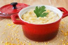 Corn perridge in red bowl Royalty Free Stock Photos